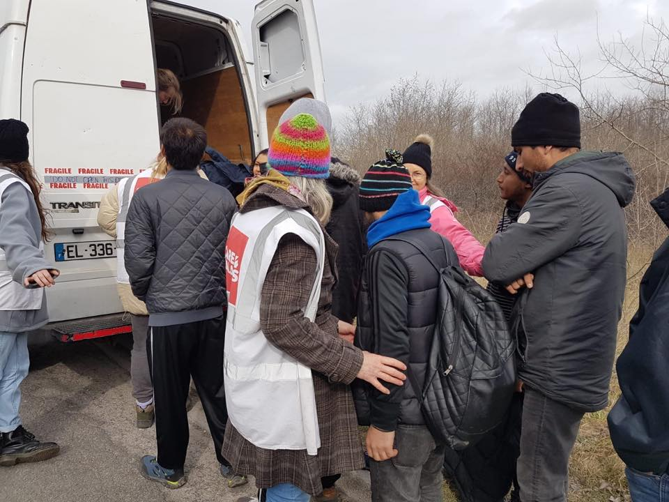 Refugees collect aid
